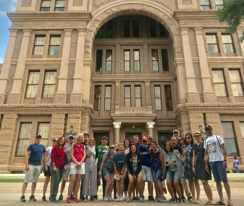 Group photo in front the Texas State Capital building
