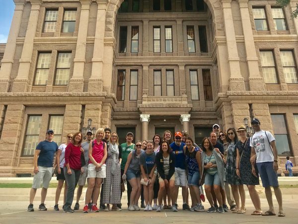 Group hanging out in front of the Texas Capital